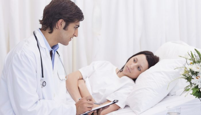 Doctor talking to his patient that just woke up