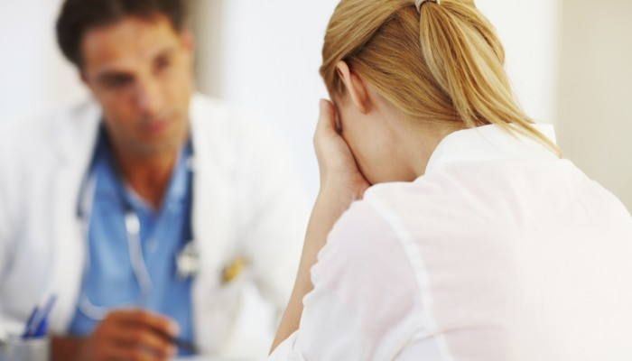 Portrait of female doctor sharing her problems with doctor in office