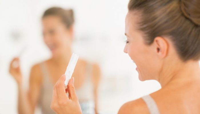 happy-woman-looking-at-pregnancy-test_0