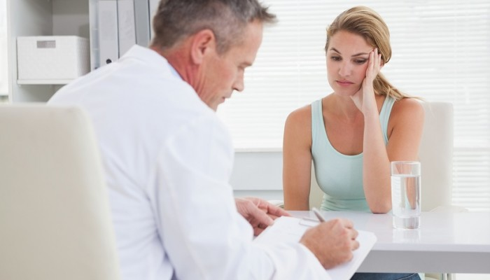 Doctor writing down what patient tells him
