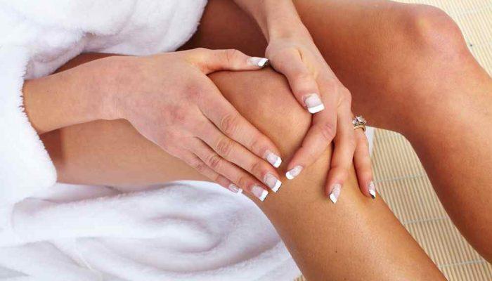 Woman having knee pain. Health care.